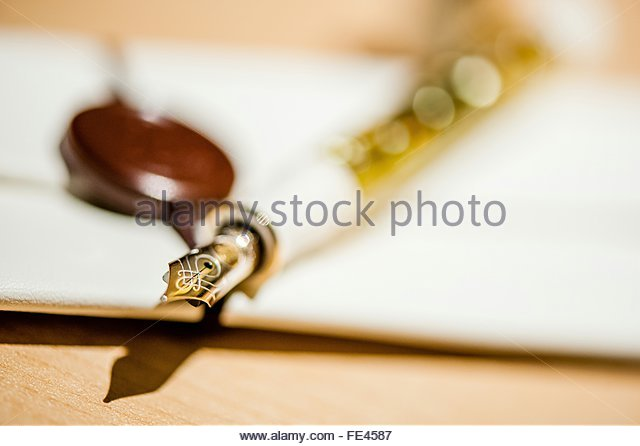 Close-Up Of Golden Pen On Table - Stock Image