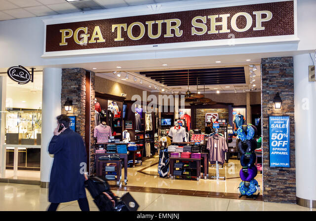 Charlotte North Carolina Charlotte Douglas International Airport CLT terminal concourse gate area shopping PGA Tour - Stock Image