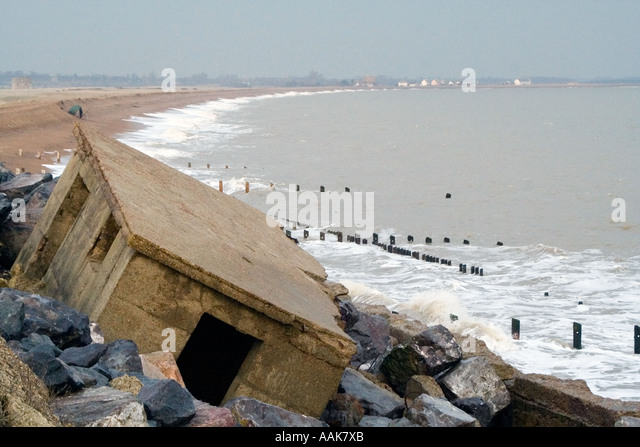 Pillbox Ruins and Rough Sea Advance East Lane Bawdsey Suffolk England - Stock Image