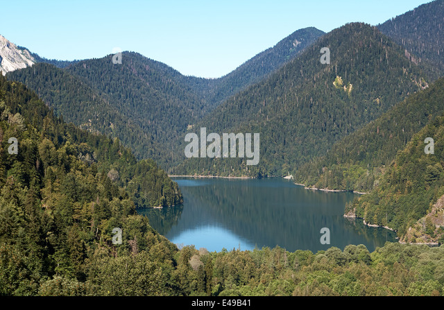 Lake Ritsa located in the northern part of Abkhazia, is a lake in the Caucasus Mountains - Stock Image