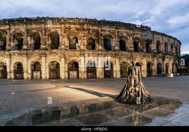 The Roman amphitheatre, Arena, Sculpture of Nimeno II, bullfighter,  Nimes, Gard Department, Languedoc-Roussilon, - Stock-Bilder