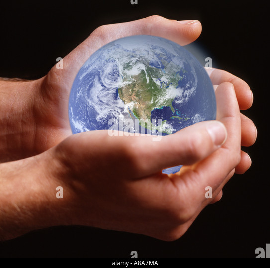 Person holding planet earth - Stock Image