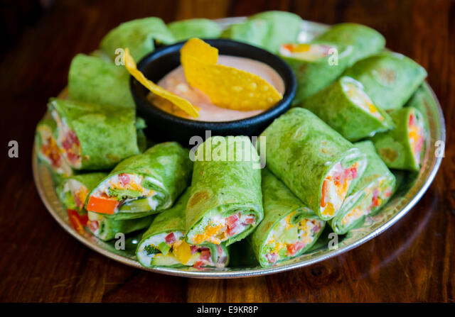 Mexican restaurant offering a gluten-free alternative to their traditional cuisine with these vegan veggie vegetarian - Stock Image