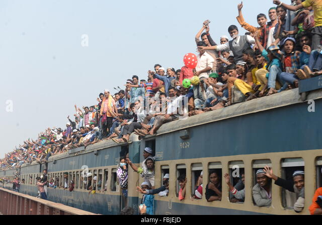 Muslim participants ride on an overcrowded train following the conclusion of the World Muslim Congregation, also - Stock Image