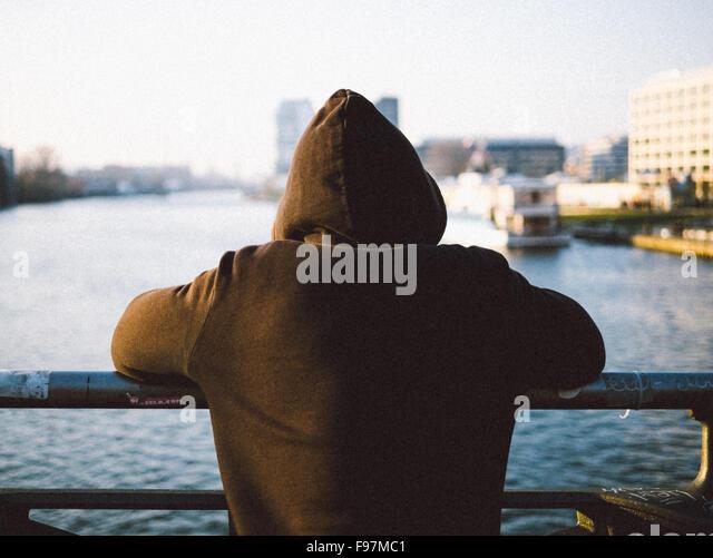 Rear View Of Man Looking At Sea - Stock Image