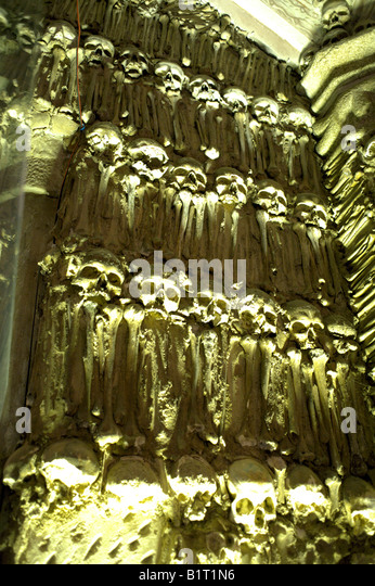 Wall decorated with human remains in the Chapel of Bones, Church of St Francis,  Evora, Portugal, - Stock Image