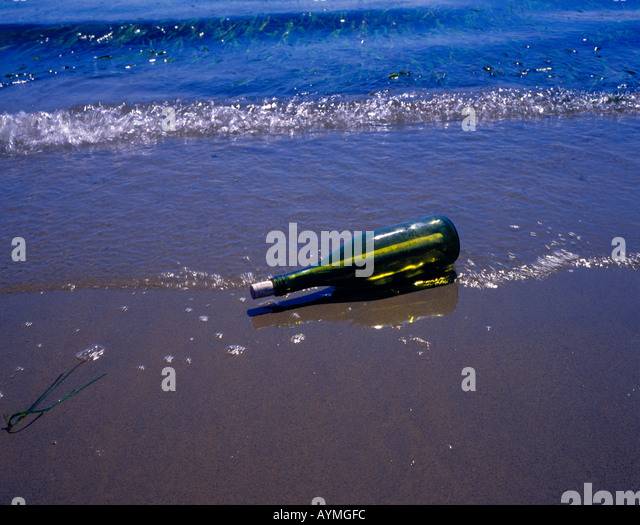 message in a bottle. Photo by Willy Matheisl - Stock Image