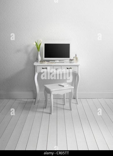 Computer and stool in minimalist room - Stock Image