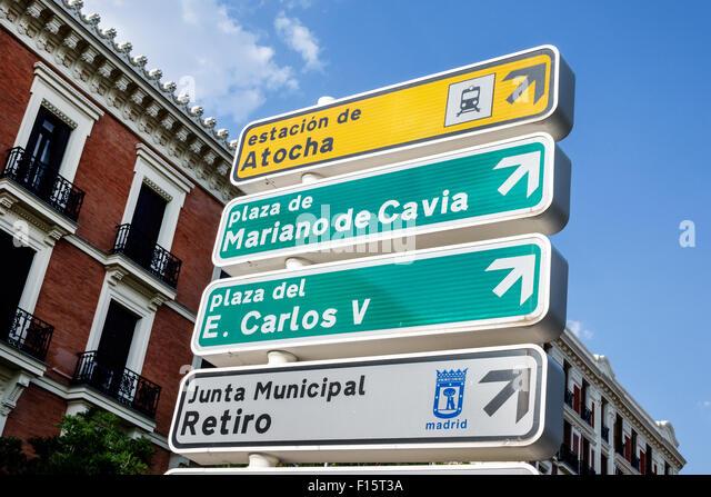 Spain Europe Spanish Madrid Retiro sign arrows directions - Stock Image