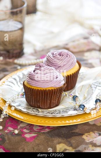 Violet cupcake - Stock Image
