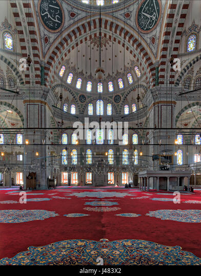 Fatih Mosque, a public Ottoman mosque in the Fatih district of Istanbul, Turkey, with a huge arches, decorated domes - Stock Image