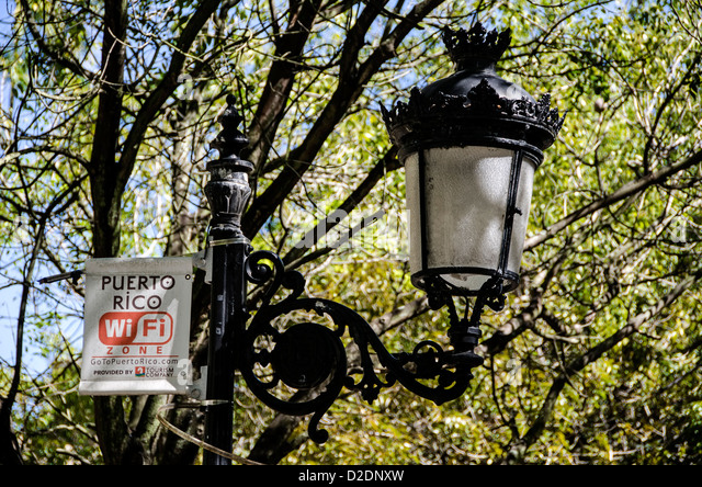 La Princesa promenade with antique street light and wi-fi sign, Old San Juan, Puerto Rico - Stock Image