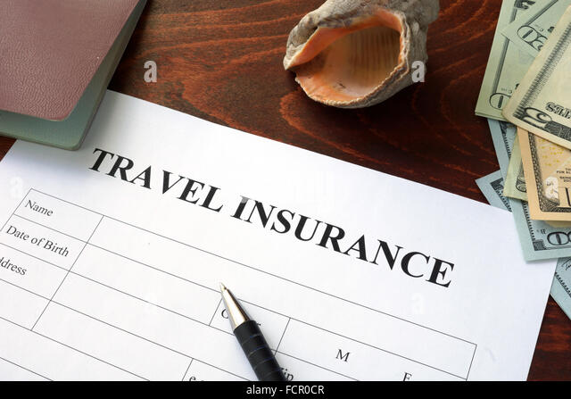 Travel insurance form and dollars on the table. - Stock-Bilder