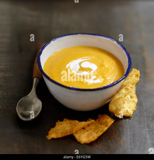 Cream of yellow turnip soup with parmesan tuiles - Stock Image