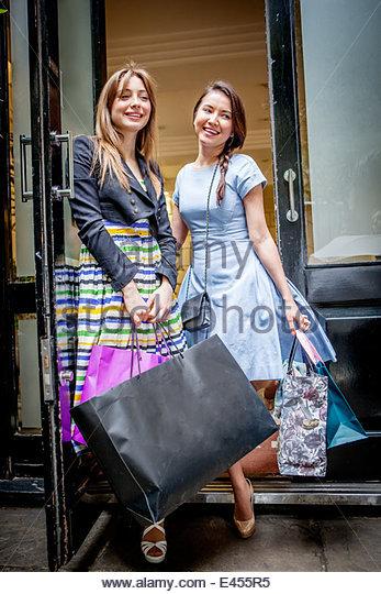 Young women carrying shopping bags - Stock Image