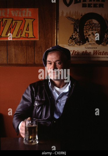 43 year-old unemployed logger with a beer in a bar in Forks, Washington on a weekday afternoon. - Stock Image