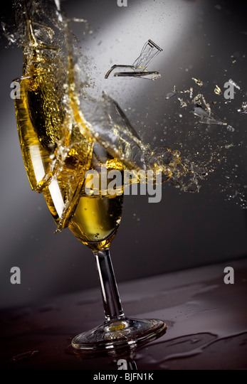 Shattering glass of champagne - Stock Image