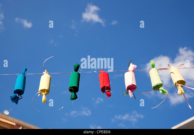 Fallas decoration fake fireworks colorful in a row rope - Stock Image
