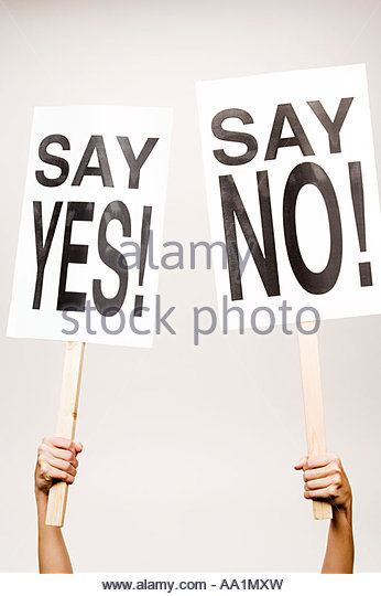 Person holding placard - Stock Image