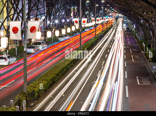 Tokyo, Japan flag lined avenue near Harajuku district. - Stock Image