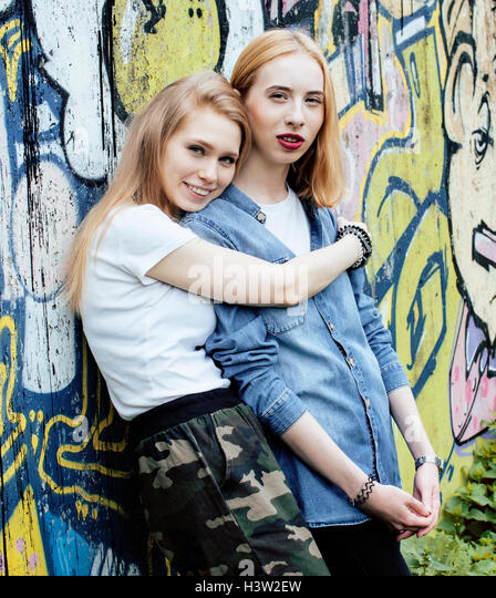two blonde real teenage girl hanging out at summer together best friends, lifestyle people concept - Stock Image