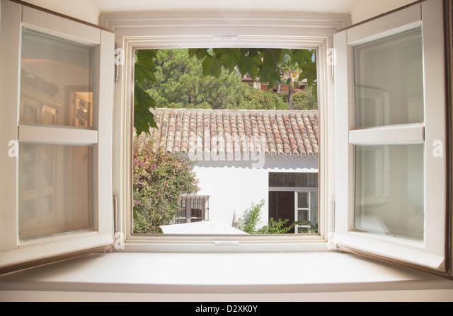 Sun shining through kitchen window - Stock Image