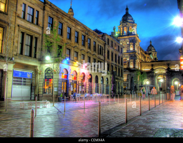 Glasgow by night John St, Merchant City Chambers, Scotland (Strathclyde UK) at dusk with a blue sky. @Hotpixuk - Stock Image