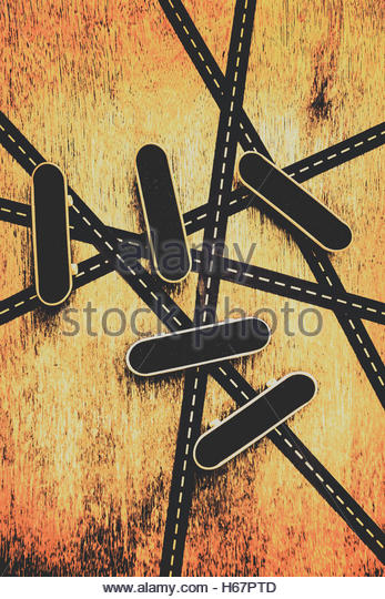 Creative artwork on skateboarder decks crossed by urban road abstract. Street skating background - Stock Image