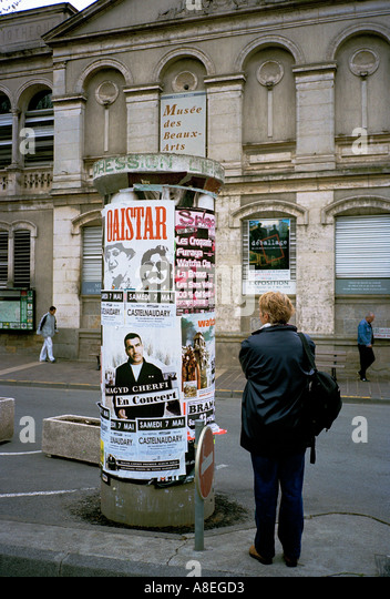 Viewing  advertising posters in Nice, on the Cote d'Azur, France, French Riviera - Stock Image