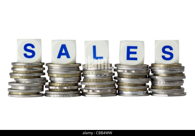 Stacks of coins with the word SALES isolated on white background - Stock Image