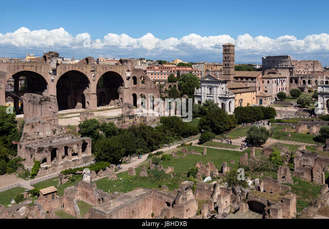 Roman Forum in the city of Rome, Italy. To the left is the Basilica of Maxentius, center is the Temple of Venus - Stock Image