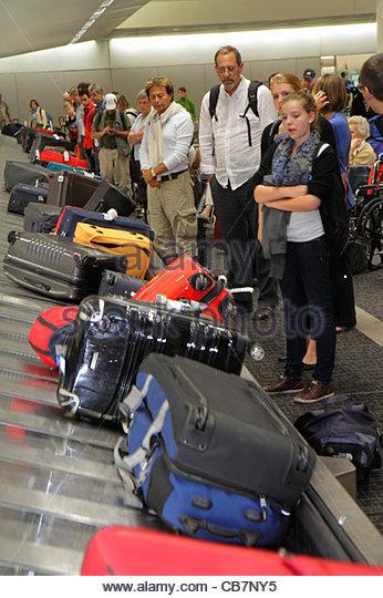 California San Francisco International Airport SFO aviation arriving flight baggage claim luggage carousel conveyer - Stock Image