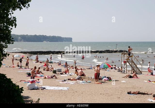 Cleveland Ohio Lake Erie Huntington Reservation Park beach sunbathers surf - Stock Image