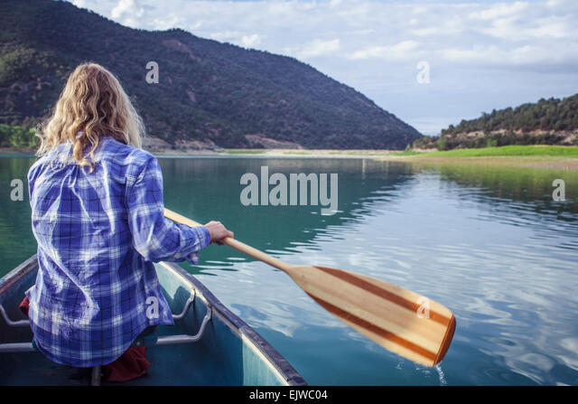USA, Colorado, Harvey Gap, Woman canoeing in lake - Stock Image