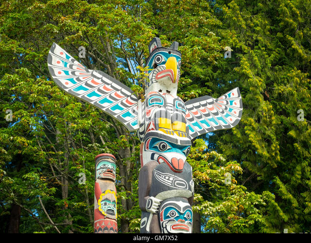 The famous totem poles at Brockton Point, Stanley Park, Vancouver, British Columbia, Canada. - Stock Image