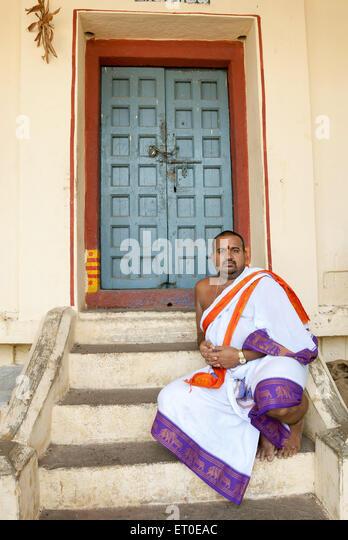 Temple Priest at Kamakshi Amman temple  ; Kanchipuram  ; kancheepuram  ;  Tamil Nadu  ; India MR#777A - Stock Image