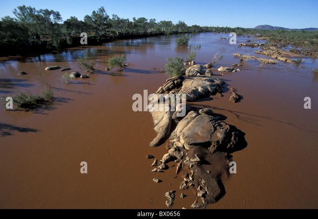 Ashburton River Australia brown desert dirty Nanutarra river rock western Australia - Stock Image