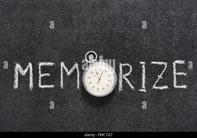 memorize word handwritten on chalkboard with vintage precise stopwatch used instead of O - Stock-Bilder