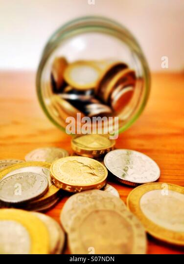 An emptied savings jar - Stock Image