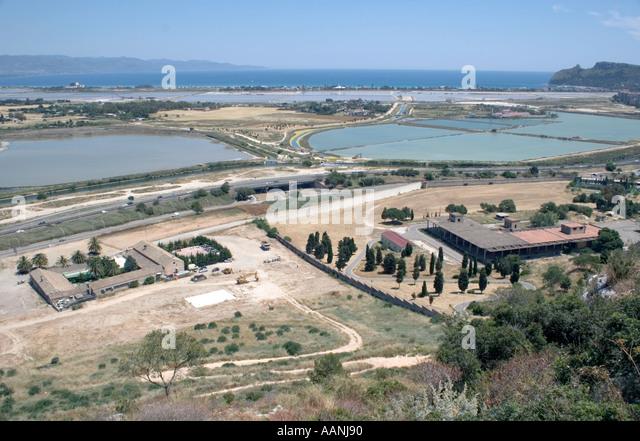 Cagliari  salt flat salt pan shallow lagoon saltflats saltpans skyline landscape rural costal travel - Stock Image