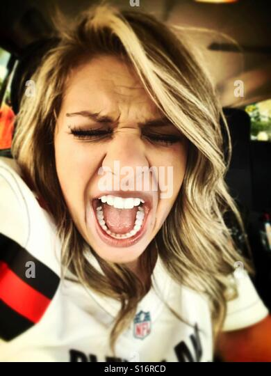 Girls making excited face while tailgating for the Cleveland browns - Stock-Bilder