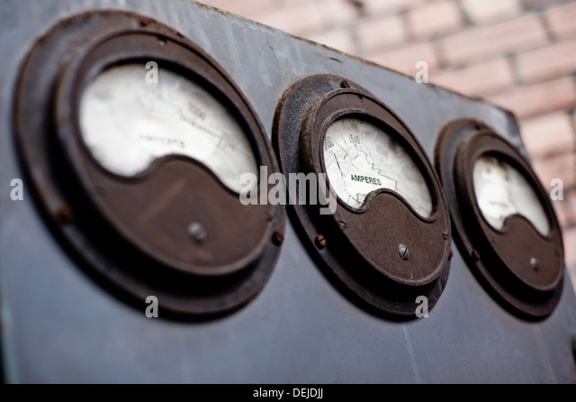 Three dials for taking measurements in disused warehouse in South Wales UK - Stock-Bilder