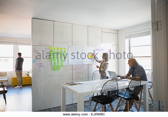 Business people brainstorming in conference room - Stock Image