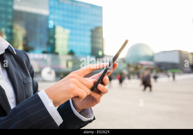Female Cell phone hand sun summer message sms e-mail - Stock Image