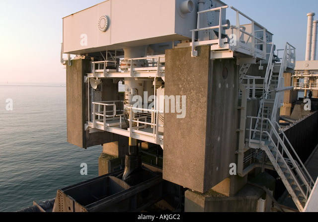 Big hydraulics valves on top of the Storm Barrier to open/close the huge doors in the barrier - Stock Image