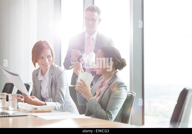 Business people having lunch break - Stock Image