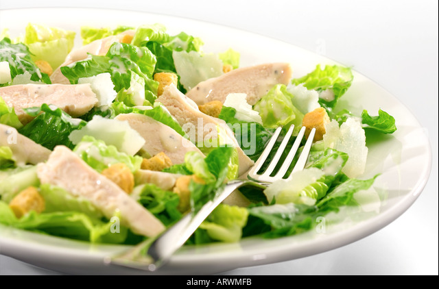 white bowl of chicken caesar salad - Stock Image