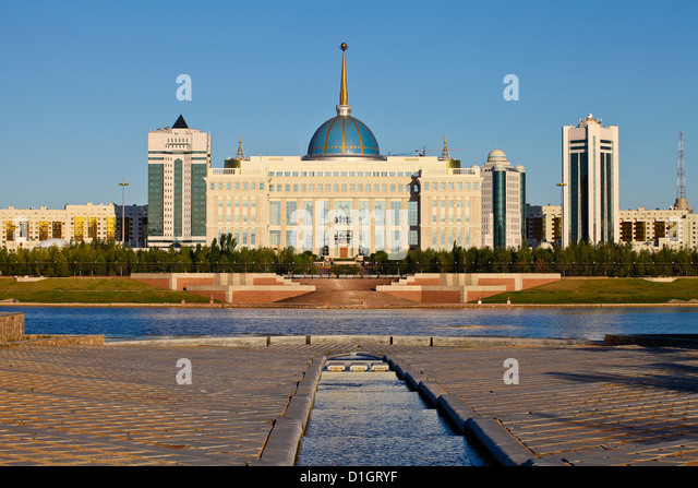 View of The Ak Orda Presidential Palace of President Nursultan Nazarbayev reflecting in Ishim River, Kazakhstan, - Stock Image