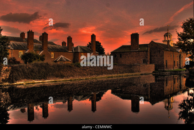 Dunham Massey NT at dusk with a red sunset sky This is National Trust near Altrincham, England UK. Its a stately - Stock Image