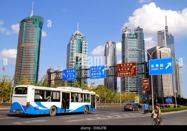 China Shanghai Pudong Lujiazui Financial District Lujiazui East Road signs directions Mandarin symbols hanzi World - Stock Image